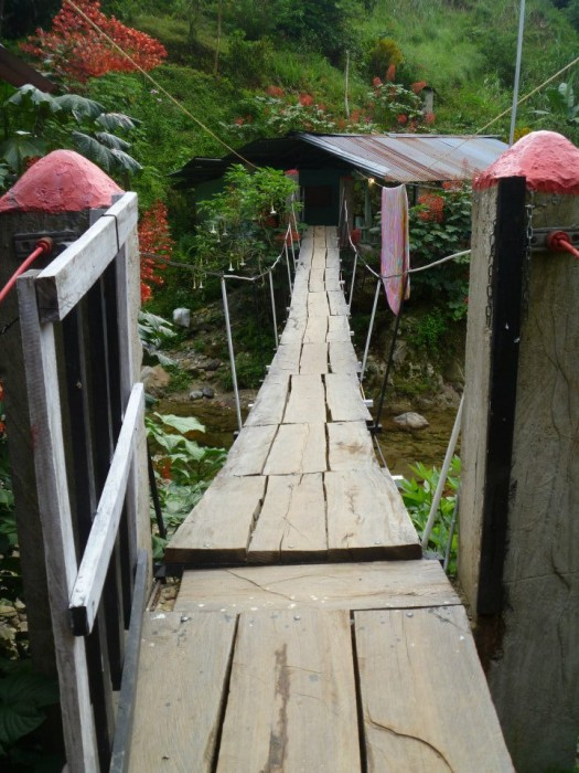Walking across the bridge to the camp site
