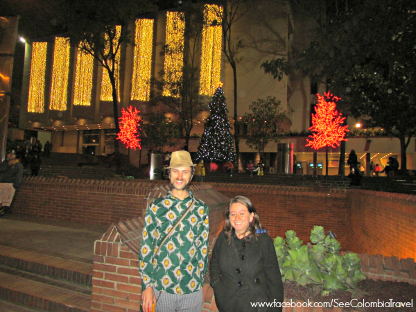 Gilesy and Carolina pose in front of the Javeriana's Christmas lights