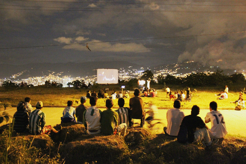 The cinema project in Manrique, with Medellin's bright lights below.