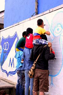 Local Bogota children getting involved in the urban art scene