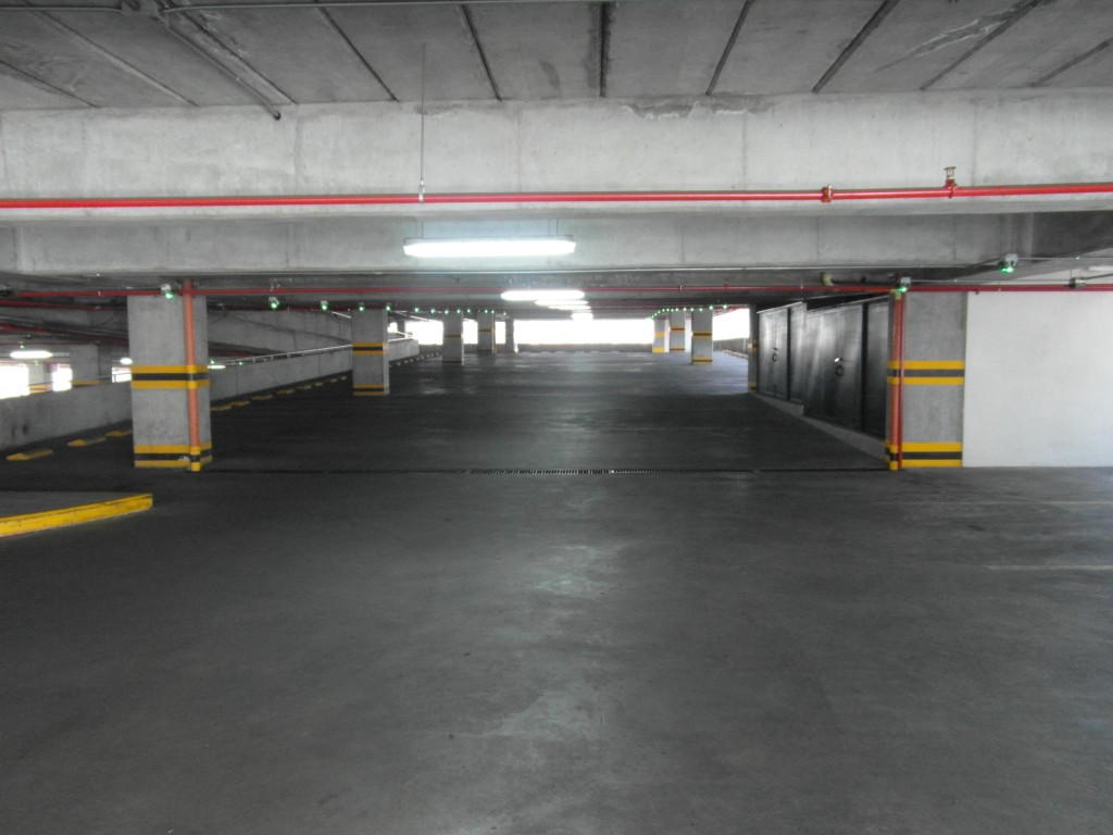 An indoor car park with no cars