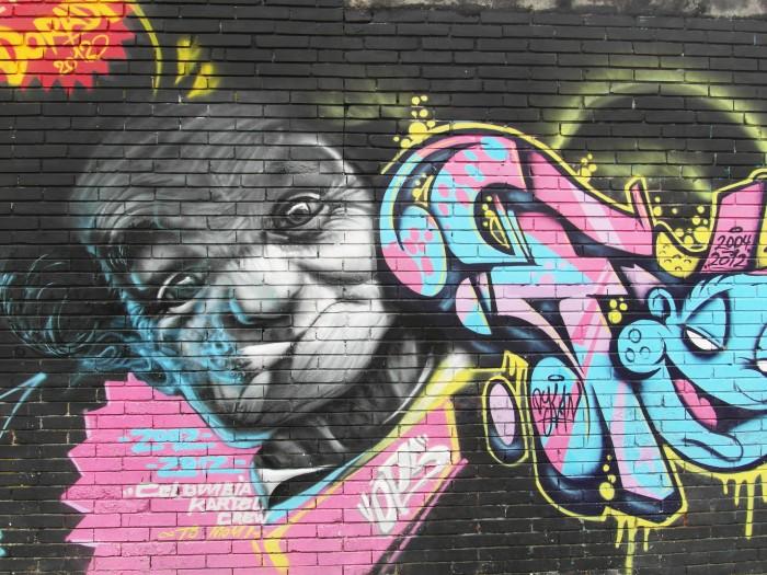 Intricate graffiti alongside some huge tags