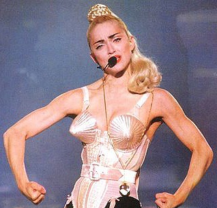 Madonna flexing in her iconic pointy bra