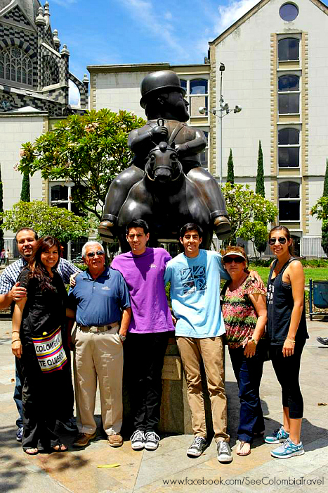 Carolina and her family in front of a Botero statue